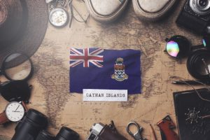 cayman-islands-flag-traveler-s-accessories-old-vintage-map-overhead-shot_1379-4141