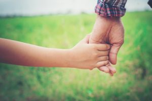 close-up-father-holding-his-daughter-hand-so-sweet-family-ti_1150-846